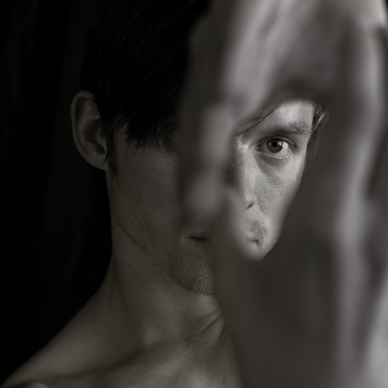 Black and white headshot of of Dancer Christian Squires